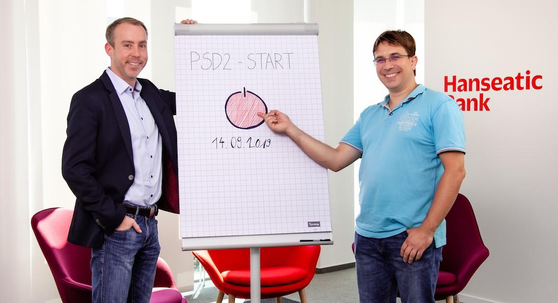 Nico Koller und Matthias Minar vor einem Flipchart mit dem Datum des PSD2-Starts