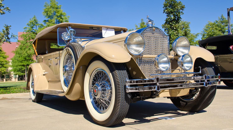 Ein wie neu wirkender beiger Packard Phaeton Model 640 von 1929 als Sinnbild für die Fahrzeugfinanzierung durch einen Autokredit